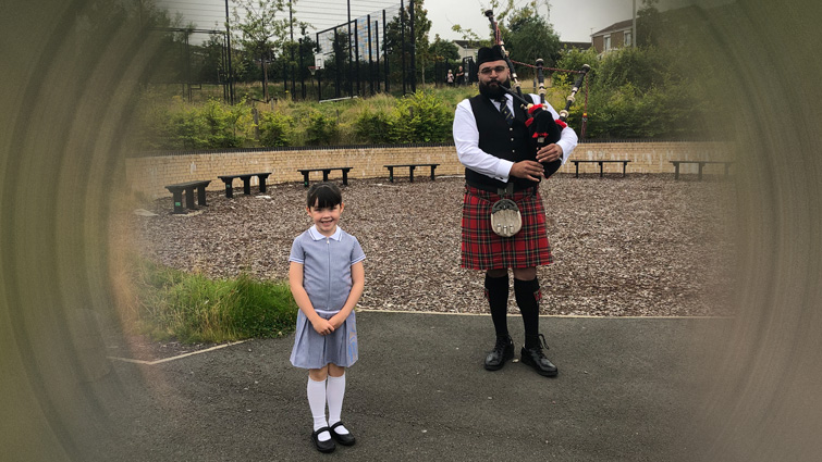 Delight for pupils as piper welcomes them back