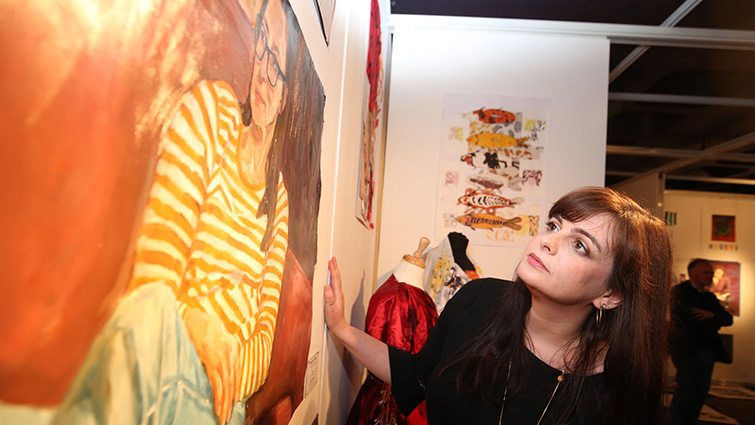 South Lanarkshire Council Chair of Education Councillor Katy Loudon inspects one of the artworks created by students studying Advanced higher Art