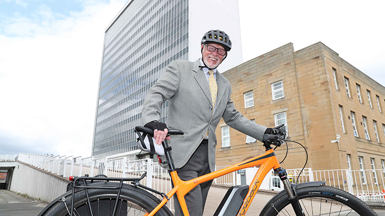 Council leader John Ross is encouraging everyone to consider the benefits of e-bikes in travelling to work.