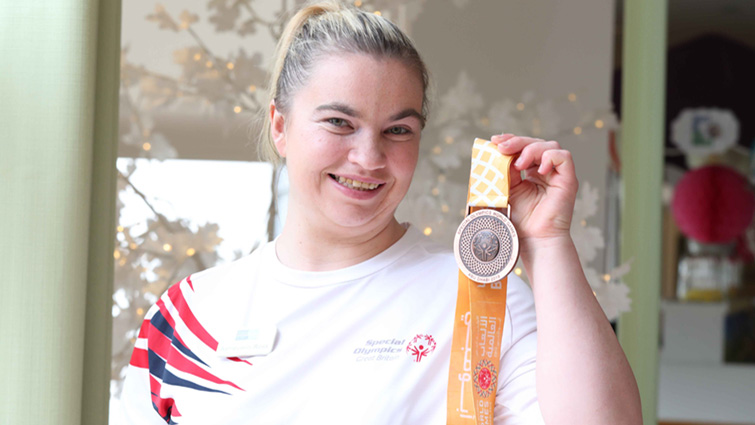 This picture shows Ashley in her Team GB shirt holding up a medal she won at the Special Olympics World Games 2019 in Abu Dhabi