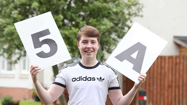 Pupil Edward shows his delight after gaining 5 As in his Highers and suffering a brain tumour