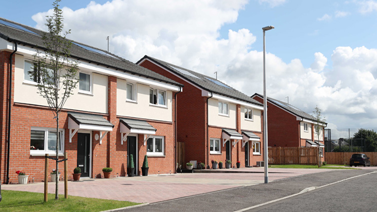 this row of new semi-detached homes with front driveway has been built on the site of the former St Blane's primary school in Blantyre.