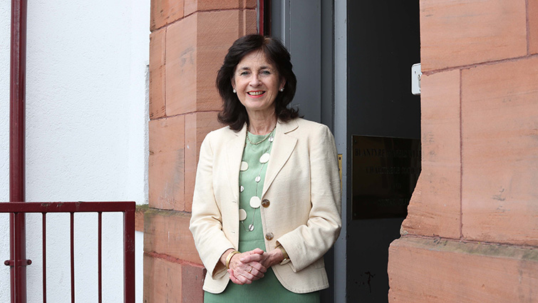 This is a picture of Val de Souza, Chief Officer of South Lanarkshire Health and Social Care Partnership. She is wearing a cream coloured jacket.