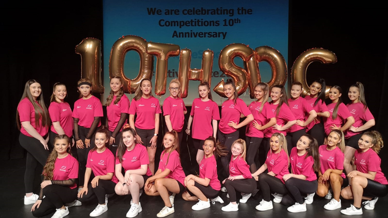 South Lanarkshire's Active Schools Dance Leaders on   stage at they annual dance competition in Hamilton Town House. They are wearing matching pink t-shirts.