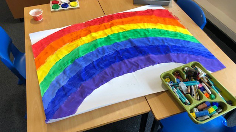 Image shows a rainbow one of the children attending the Biggar school hub has painted during the coronavirus crisis