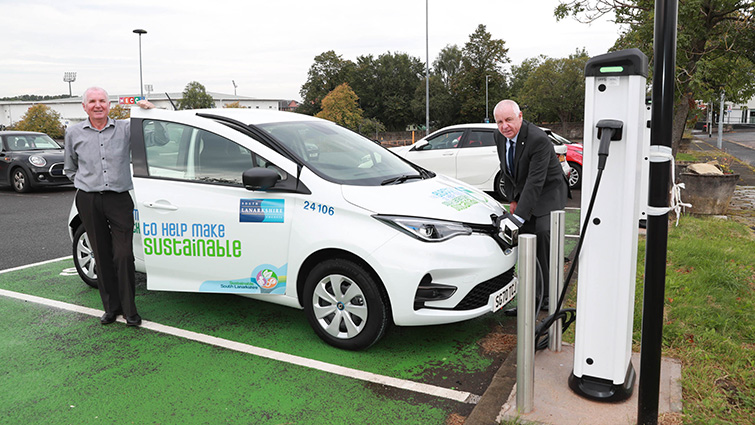 Councillor John Anderson and Ian Mills from Renault photographed next to one of the new Renault ZOE electric vehicles