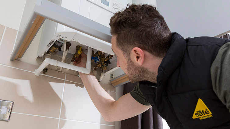 An engineer checks a boiler to highlight Gas Safety Week 2020