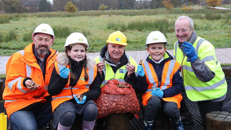 Pupils from St Leonard's Primary School are joined by Councillor John Anderson and representatives from Covanburn and Community Links at Glen Esk, East Kilbride