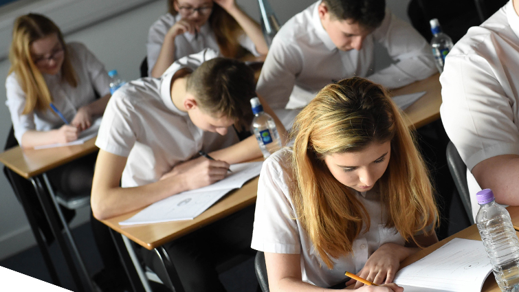Pupils in a classroom studying for exams