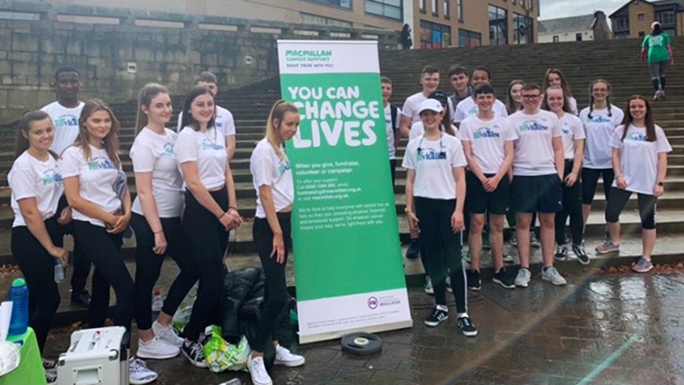 This is a picture of a large group of the Hamilton Grammar pupils who ran Revitalise for the Scottish Youth Enterprise Awards