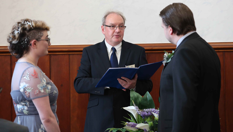 A couple are married by South Lanarkshire Council registrar Alistair Gray