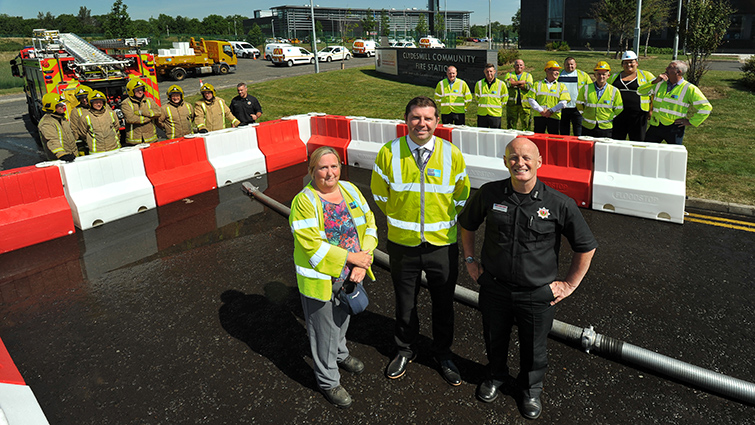 Representatives of South Lanarkshire Council and the Fire Service at testing of the new flood barriers